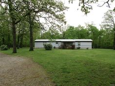 """3 Bedroom 2 Bath Trailer on 126 acres. Lebanon School District. Home & Property is very well maintained. Hot water and heat comes from Taylor water stove purchased in 2001 ($9,000.00) High quality roof (3"""" insulation) was put on in 2003 along with both 16x16 covered desks. 1500 Sqft garage has 3 bay with automatic openers. Concrete floors, electric (both 110 & 220) and Excellent lighting. Beautiful landscaping! 2600 Sqft. Pole barn with big enough doors for RV mostly wooded in Grovespring MO"""