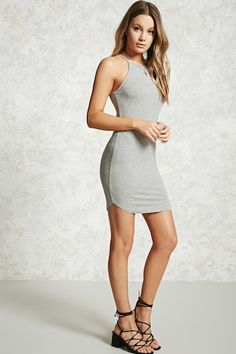 A ribbed knit dress featuring cami straps, a bodycon silhouette, and a dolphin hem.