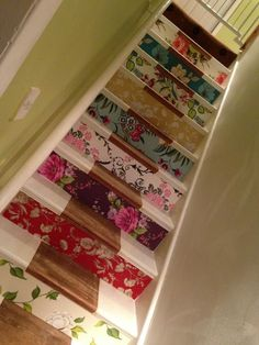 Wallpaper staircase - I kinda like this idea... different patterns though :)