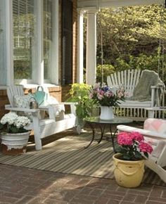 Cute porch with wicker funiture and swing from Wrightsville Beach Magazine