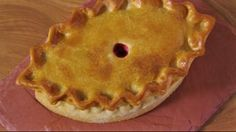 Make the most of Christmas dinner leftovers with a turkey, stuffing and cranberry pie made with hot water crust pastry.