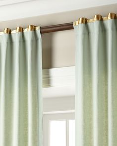 "Linen curtains with metallic ribbon band trim at top. Styled with a rod pocket and back tabs. Lined and weighted. Each curtain is approximately 52""W. Dry clean. Imported."