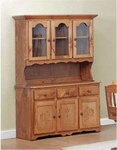 Chelsea Home Furniture proudly offers the Edgartown 3 Door China Hutch with Rooster and Wheat Inserts Golden Oak handcrafted with the heirloom quality furniture. custom made for you. What makes heirloom quality furniture It s knowing how to turn a. Golden Oak, Golden Eagle, White Cedar, Quality Furniture, Types Of Wood, Log Homes, Adjustable Shelving, Rooster, Chelsea