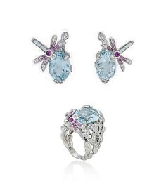 A SUITE OF AQUAMARINE AND DIAMOND JEWELLERY, BY DIOR Comprising a dress ring with central oval-cut aquamarine to a circular-cut diamond pierced leaf motif surround, with further pink sapphire and mother-of-pearl-set dragonfly accent, raised on chased shoulders and plain hoop; together with earrings of matching design, ring size M, 2.4cm long, in maker's case Each signed Dior