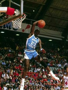 After a duel with should have been superstar Len Bias, Michael Jordan finishes off the win with a breakaway swoop and scoop dunk at Maryland.
