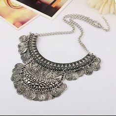 Silver Metal Alloy Statement Coin, Bib 2 tier Brand new - high quality Hot Bib Necklace of alloy metal  Size is appeoximate - size fits all,42+6cm, Pendant:12*8cm  [1cm=0.39inch]  Note: size may vary 2cm/1i nch inaccuracy is due to measuring by hand Jewelry Necklaces