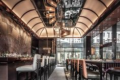 AMMO Restaurant and Bar in Hong Kong by Joyce Wang   Modern, minimalist, industrial or retro style bars. Learn how to create the best ambiences! Check out http://www.pinterest.com/homedsgnideas/ for more amazing ideas.