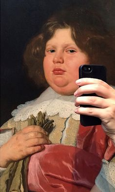 Olivia Muus, a designer and marketer based in Denmark, has created a series of fun and light-hearted photos of old portraits in art museums that make it look as if their subjects are taking selfies. Her series is the perfect marriage of historical art and everyone's favorite modern reinterpretation of the portrait - the selfie.