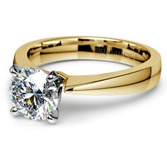 Propose to your sweetheart with the elegant, classic style of the Flat Taper Diamond Solitaire in Yellow Gold!   http://www.brilliance.com/engagement-rings/flat-taper-solitaire-ring-yellow-gold (Proposal suggestion: Set a date with her to a fancy place, then show up at her doorstep wearing pyjamas and carrying a pizza (with the ring taped to the box). Tell her that you're sorry for canceling the fancy date, but you hope she doesn't mind seeing you this way for the rest of your life..)