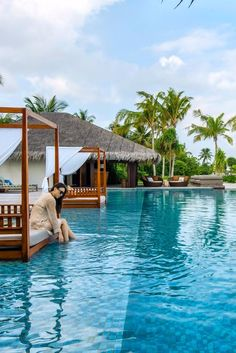 Thatch-roofed Water Villas hover above the Indian Ocean. The Residence Maldives (Maldives) - Jetsetter