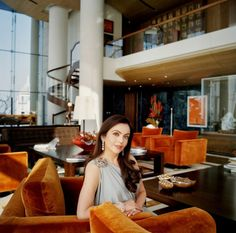 Nita Ambani Owner of the World's Most Lavish Home. Love the plush, rich colours of the sofas, furniture and surrounds. Can imagine how it looks at night.
