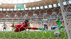 Emmanuel Emenike of Nigeria 'scores' past Hugo Lloris of France but it was disallowed during the 2014 FIFA World Cup Brazil Round of 16 match between France and Nigeria at Estadio Nacional on June 2014 in Brasilia, Brazil. World Cup 2014, Fifa World Cup, Hugo Lloris, Pogba, Laws Of The Game, International Football, Premier League Matches, Team Photos
