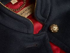 A Burberry military jacket smartly cut from a wool-cashmere weave and flanked by crested brass buttons. The silhouette is constructed with an internal quilted lining to seal in the heat when temperatures drop.