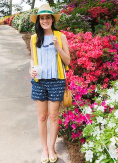Shirt by Rebecca Minkoff, shorts by Anthropologie, bag by Bosom Buddy Bags, shoes by Tory Burch. (April 14, 2015)