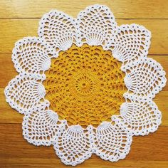 This adorable daisy doily was crocheted by myself using cotton thread. It is a modified version of my sunflower doily. It measures right around Add a little happy to any room in your house Free Crochet Doily Patterns, Crochet Circles, Crochet Squares, Crochet Motif, Hand Crochet, Crochet Stitches, Knitting Patterns, Crochet Sunflower, Pineapple Crochet