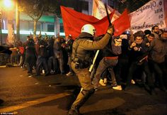 Greece.    A riot policeman attacks protesters during the demonstration, but it wasn't just protesters that seemed to be showing hate towards Obama and the US