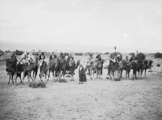 T E LAWRENCE and his mounted body guard 1918