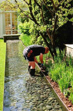 32 Outrageously Fun Things You'll Want In Your Backyard This Summer Backyard stream. The kids would love to play in the water, even if it was a square shape stream area coming of of a Slate Rock Waterfall stream. Backyard Stream, Backyard Landscaping, Backyard Ponds, Landscaping Ideas, Backyard Bbq, Garden Stream, Backyard Ducks, Backyard Hammock, Backyard Poultry