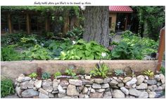 The stone wall around the Patio and across from the hillside Hasta Garden
