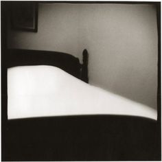 A Woman's Bed, Logan, Ohio in 1970, from the series Iowa, by Nancy Rexroth, made with a Diana camera.