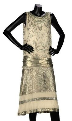 Cocktail Dress, Lucien Lelong: ca. 1920's, silk embroidered with faceted blown glass beads in an Art Deco style to the bodice, drop-waisted skirt of lamé with beadwork, silver lamé sash belt.