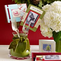 Instant Decorating - Holiday cards add instant color to any spot in the house. Try this clever way to use a fork to show them off.  -  What you need:  Ribbon, Glasses, vases or jars, Greeting cards, Forks - Wrap ribbon around glasses, vases or jars.   Place cards in forks and arrange in glasses, vases or jars.