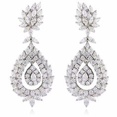 Diamond 18k White Gold Dangle Earrings. 84 Marquise cut, 2 pear cut and 58 round brilliant cut white diamonds, F color, VS2 clarity and excellent cut and brilliance, weighing 12.26 carats total. 2.5in long. $26,970