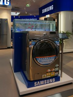 Each washing machine is backed by a fish tank filled with fake fish. When the machine is turned on, water drains from the tank to fill the m...