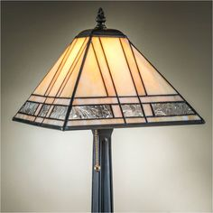The J Devlin lamp 380-2 autumn floral stained glass table lamp is of classic mission style stained glass. It has multiple amber and opalescent colored glass panels, accented with clear autumn floral f