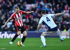 Sebastian Larsson of Sunderland takes on Chris Baird of West Bromwich Albion during the Barclays Premier League match between Sunderland and West Bromwich Albion at Stadium of Light on February 21, 2015 in Sunderland, England. #Seb