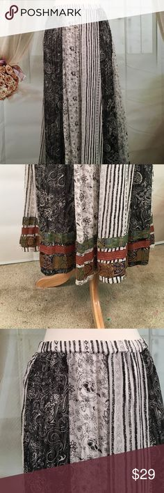 """Chico's Bohemian Style Skirt 100% Silk Very nice Bohemian style skirt. 100% silk. Elastic waist for a comfortable fit. Great condition. Size 3.  Waist 32 and length 36"""".  Chicos size 3 converts to a size XL.  All measurements are approximate. Offers are always welcome.  SK95 Chico's Skirts"""