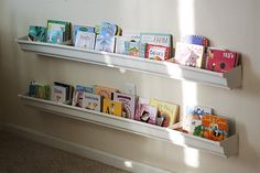 "so cute - rain gutter book shelves.  This would be great to organize toys for a kids room too.  They like to ""see"" the toys.  This would keep them from dumping their toys as much to find something."