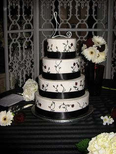 White Wedding Cake with Black Flowers
