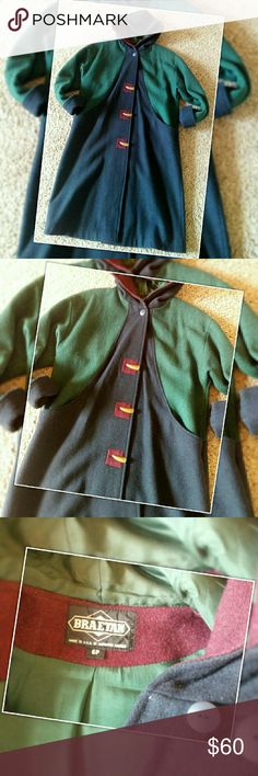 Vintage Braetan Long Coat Flawless, with a small hole in the right pocket. This beautiful vintage coat will keep you nice and warm this winter! Braetan wool mix long coat size 6P. 80% wool 20% nylon. Dry clean only! Blue, green and maroon. Braetan Jackets & Coats