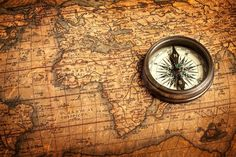 Stock image of 'Old vintage retro compass on ancient map'