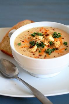 Wisconsin Cauliflower Soup  Servings: 4-6     Ingredients  3 tablespoons unsalted butter 1 medium yellow onion, chopped 1/4 cup flour 2 cups milk (I used skim, which worked well) 1 and 1/2 cups water 2 cups vegetable broth 2 heads cauliflower, chopped, plus more to roast and to garnish with, if desired 1 teaspoon Dijon mustard 2 cups white cheddar cheese