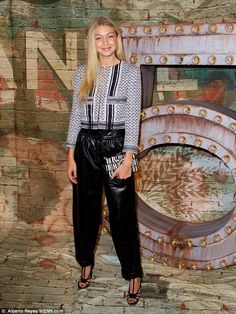 Gigi Hadid kept it low key in a black and white jacket paired with shiny oversized black leather trousers for a celebratory Chanel dinner http://dailym.ai/1w0Ru3f