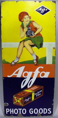 Rectangle sign with a very beautiful design depicting young girl using camera. Amazing color and details. Four mounting hole along each side and two across the bottom and top.