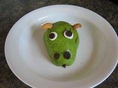 Love it...doin' it! Dragon Snack: 1/2 pear, smushed mini marshmallows, choc chips, raisins, cashew horns