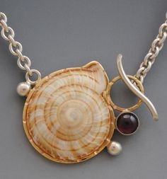 gallery 5- toggle collection - barbara umbel jewelry design - snail toggle necklace snail shell set in 14ky gold and sterling silver with garnet. $ 475.00