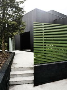 Green stained fence ; Gardenista. Plus burnt timber edger. Restrained but natural elegance.