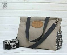 http://borboletaaffair.com/product/crossbody-ivy-canvas-tote-in-gray-triangle-pockets/