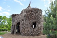 "branch structure built by artist/sculptor Patrick Dougherty. ""Little pig, little pig, let me come in."""