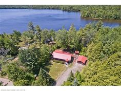 Quiet and serene lakefront log home on McWain Pond. Lovely dock with sandy entry and great fishing! Enjoy a bbq or morning coffee on the gorgeous screened porch overlooking water and mountain views. Year round well maintained property with new shower, large pantry, cozy wood-stove, and sun-room. Newer roof, garage, furnace, and porch. Home is being sold furnished, with exceptions to some personal items. Kayaks, aluminum boat, and grilles are also included in the sale!
