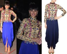 GET THIS LOOK  Nargis Fakhri rocked a bold look in an embroidered dhoti gown by designer Sonaakshi Raaj.  Shop at: http://www.perniaspopupshop.com/designers/sonaakshi-raaj