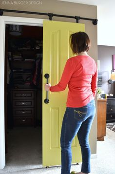 DIY: Rolling door hardware using plumbing pipe. Get the look + function of a rolling door for about $60. Custom size to fit your space. Tutorial by www.JennaBurger.com