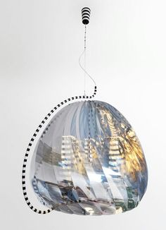 """""""Objects and their manufacture are inseparable, you understand a product if you understand how it's made"""" -JONATHAN IVE - (Unique chandelier from Dutch designer Bertjan Pot. It consists of three small half reflective, half transparent light-shades, each shaped like a propellor and balanced on a small steel tip. The smaller shades are surrounded by a fourth larger shade and the rising air, heated by the three halogen bulbs makes all four light-shades)"""