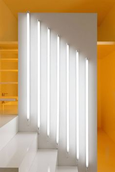 Very modern accessory. Instead of ceiling lights, this homeowner installed tube lights on the wall.