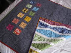 Pretty rainbow quilt. Love the grey on the back.