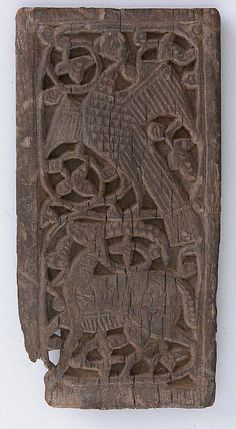 Panel  Date:     10th–12th century Geography:     Egypt Medium:     Wood (ebony); carved Dimensions:     H. 13.7 cm W. 7 cm Classification:     Wood